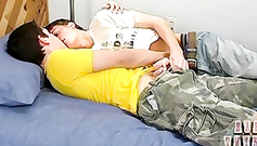 Young gay is lying and enjoying hot blowjob